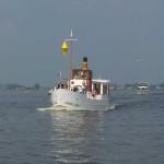 Schiff mit gelbem Doppelkegel gilts als Fähre und als Fahrzeug